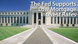 The Fed raises the Fed Funds Rate, pledges support for low mortgage rates into 2016