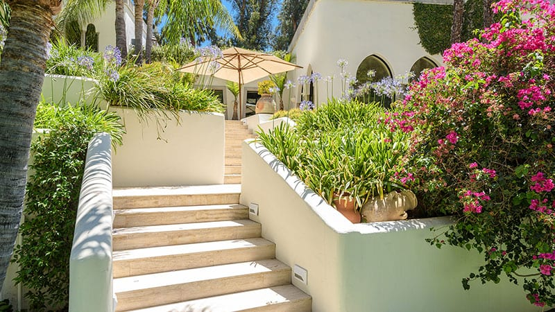 Stucco Facades and Steps at Cher's Former Mansion