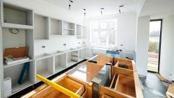 Bright, sunny kitchen being remodeled with new counters and appliances